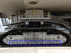 Recent work on crawler-transporter-2<br /> includes preparations to install upgraded<br /> roller bearing assemblies. The area where<br /> the assemblies are located is circled in<br /> blue.<br /> Photo credit: NASA&nbsp;&nbsp; <br /> <a href='http://www.nasa.gov/images/content/738560main_Roller%20Bearing%20Side%20View.jpg' class='bbc_url' title='External link' rel='nofollow external'>� View Larger Image</a>